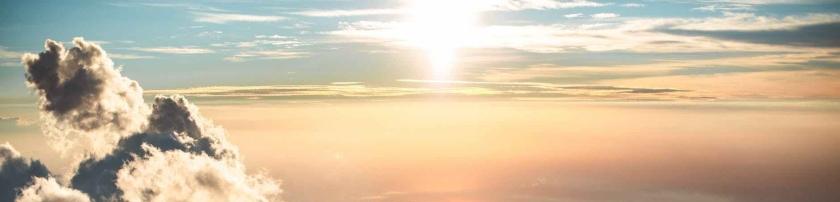 cloudy sky above hilly terrain during sundown